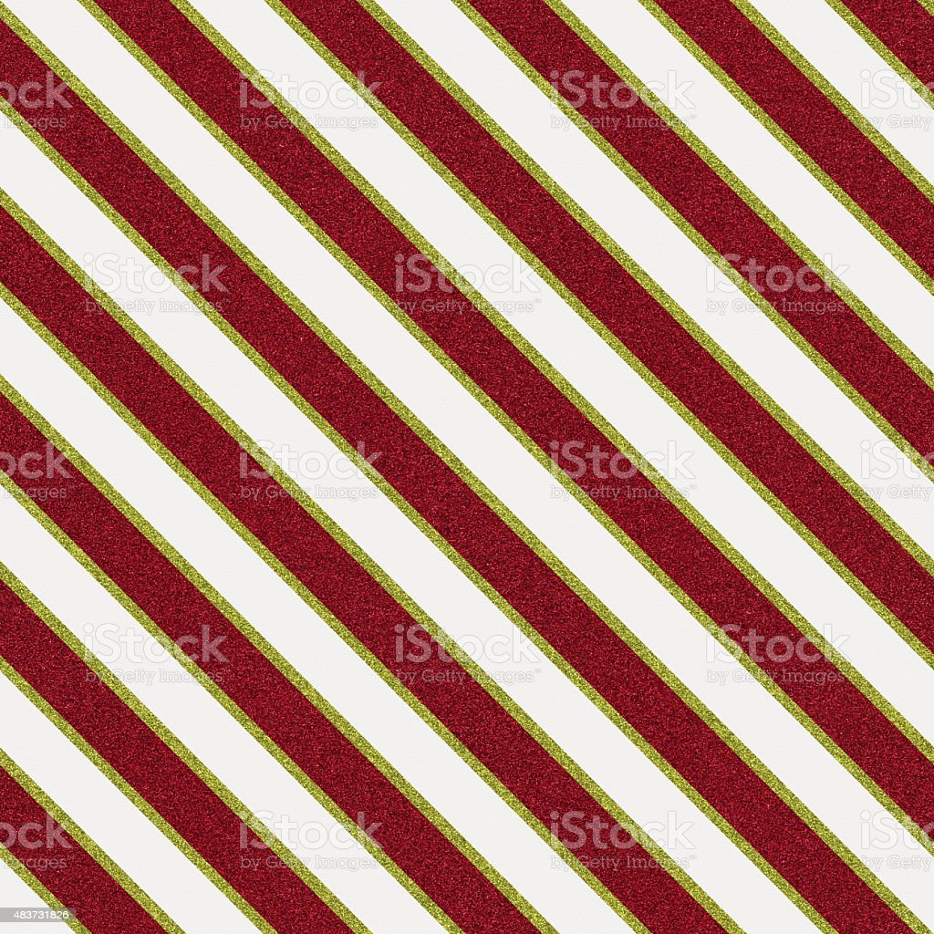 Seamless glitter stripe pattern on white textured paper stock photo