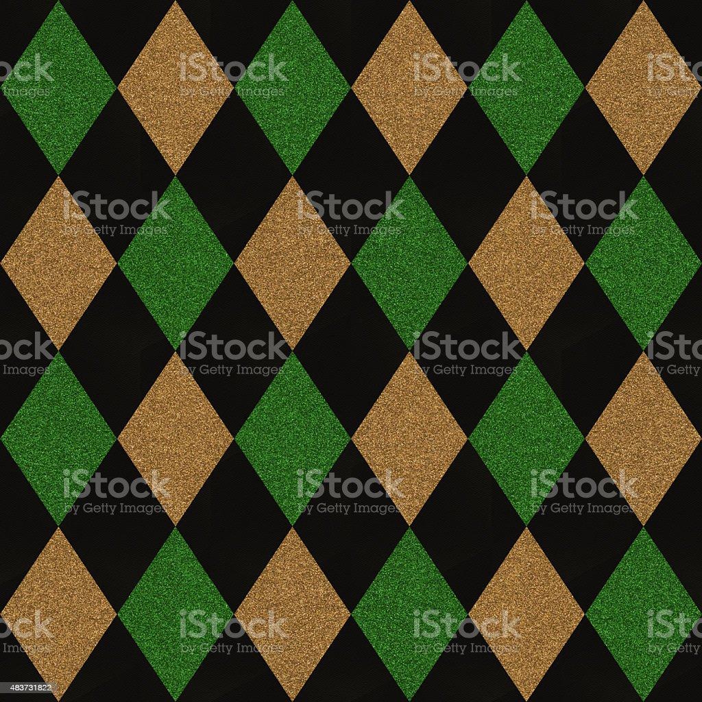 Seamless gold and green glitter diamonds on black paper stock photo