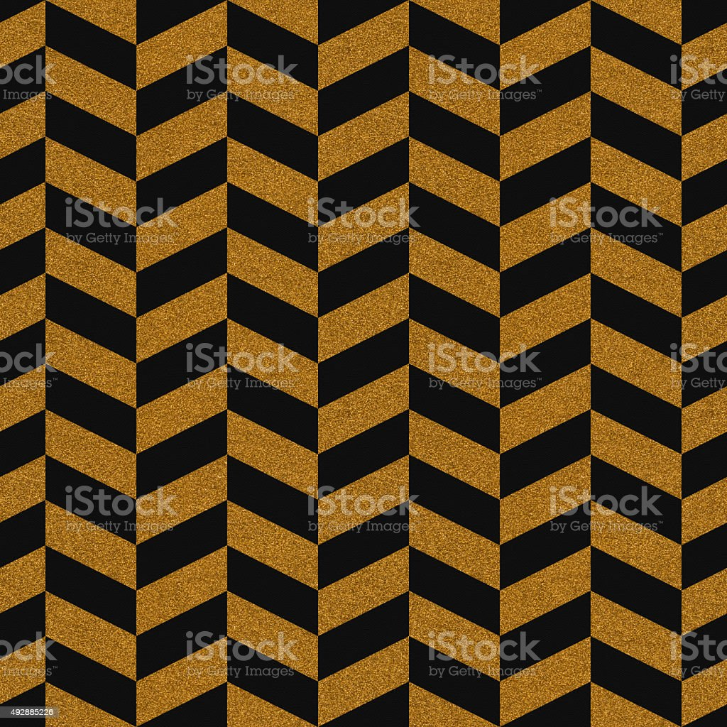 Seamless gold glitter chevron pattern on textured paper stock photo