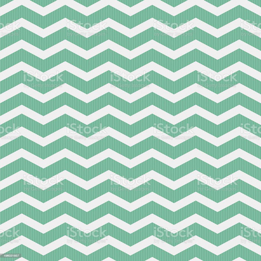 Seamless green chevron pattern on textured paper stock photo