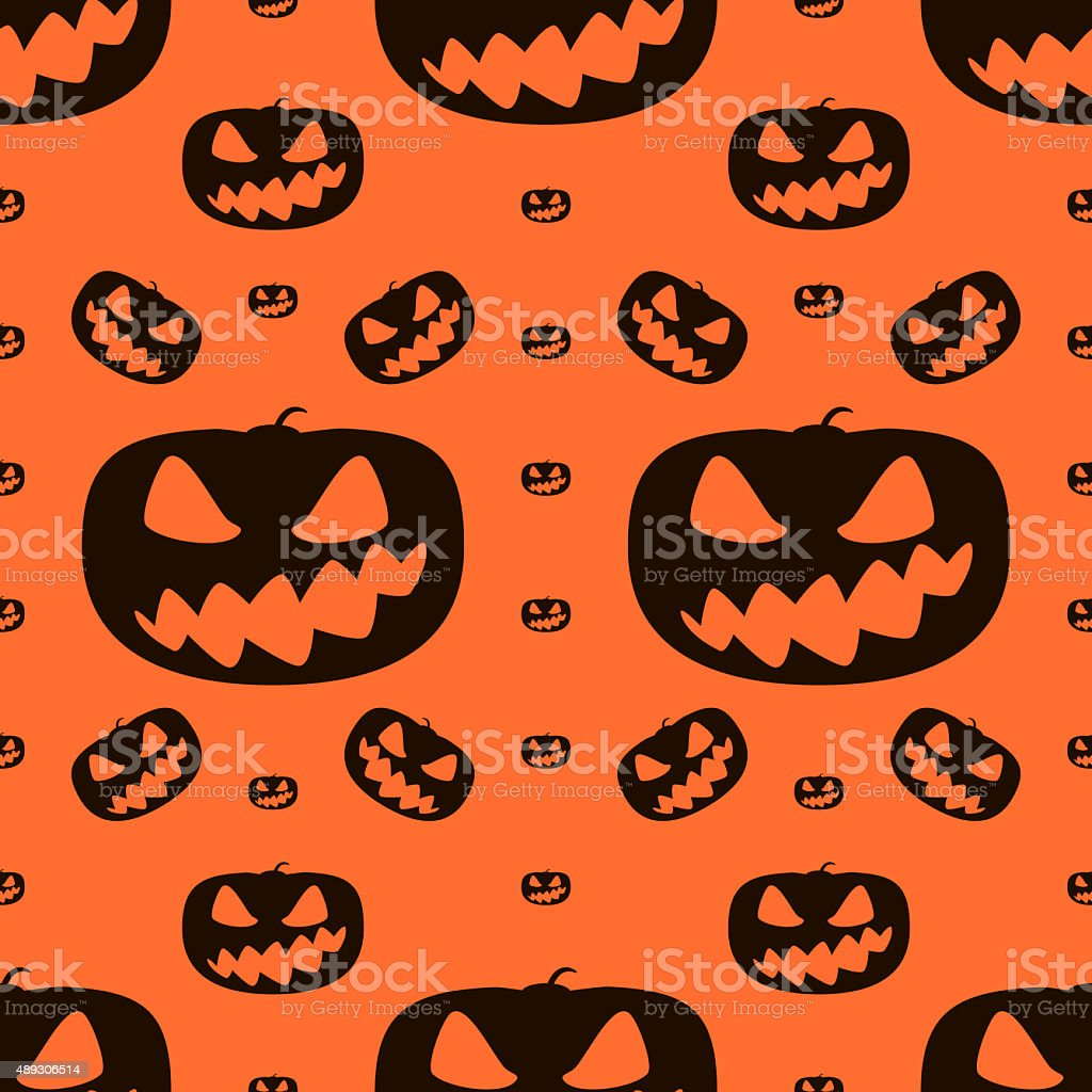 Seamless Halloween pattern of wickedly grinning pumpkins stock photo