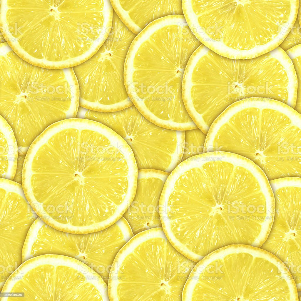 Seamless pattern of yellow lemon slices stock photo