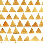 Seamless pattern with hand drawn gold triangles.