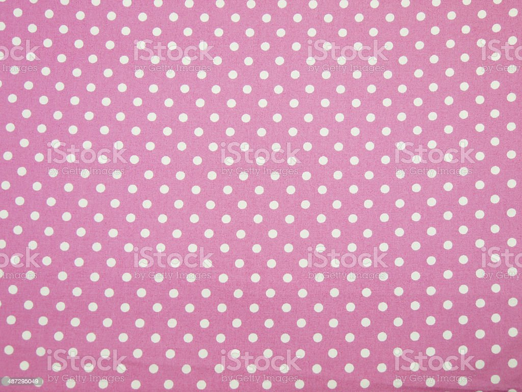 Seamless pink and white polka dot fabric background stock photo