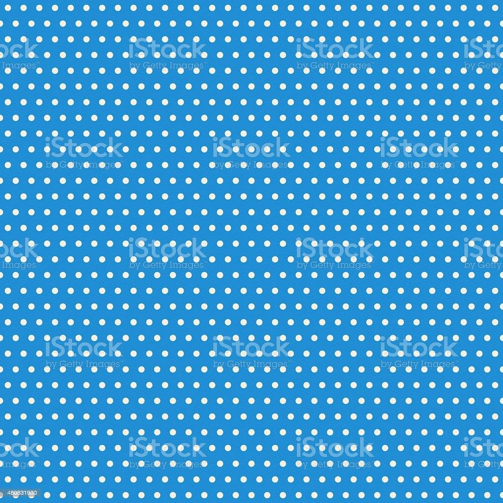 Seamless polka dot pattern on blue paper stock photo