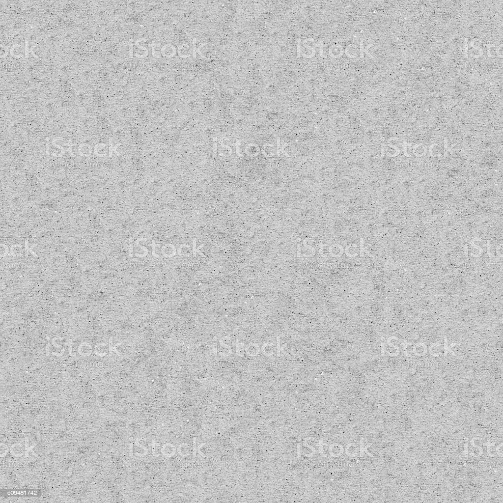 Seamless raw rough grunge dotted gray paper wall texture background stock photo