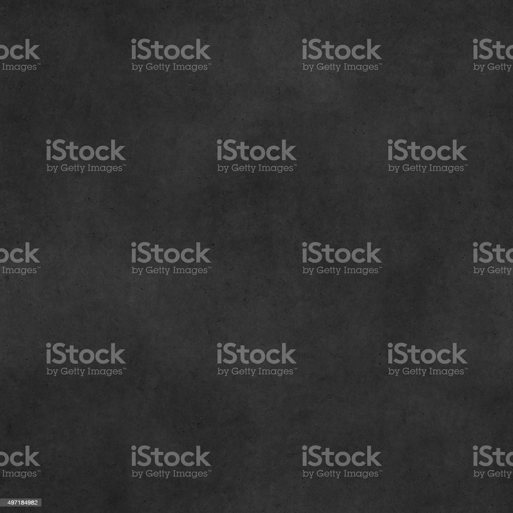 Seamless raw uneven polluted dotted black concrete stone block texture stock photo
