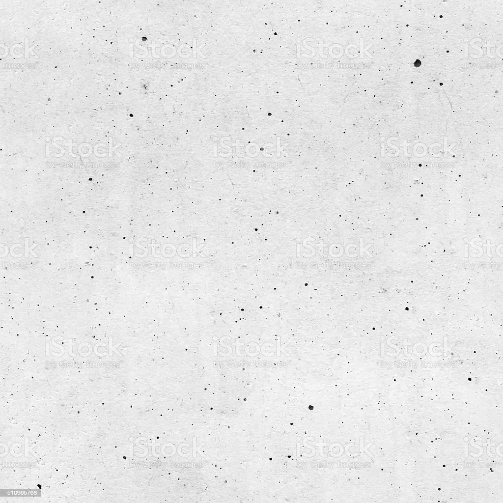 Seamless raw unfinished dirty dotted white painted concrete wall background stock photo