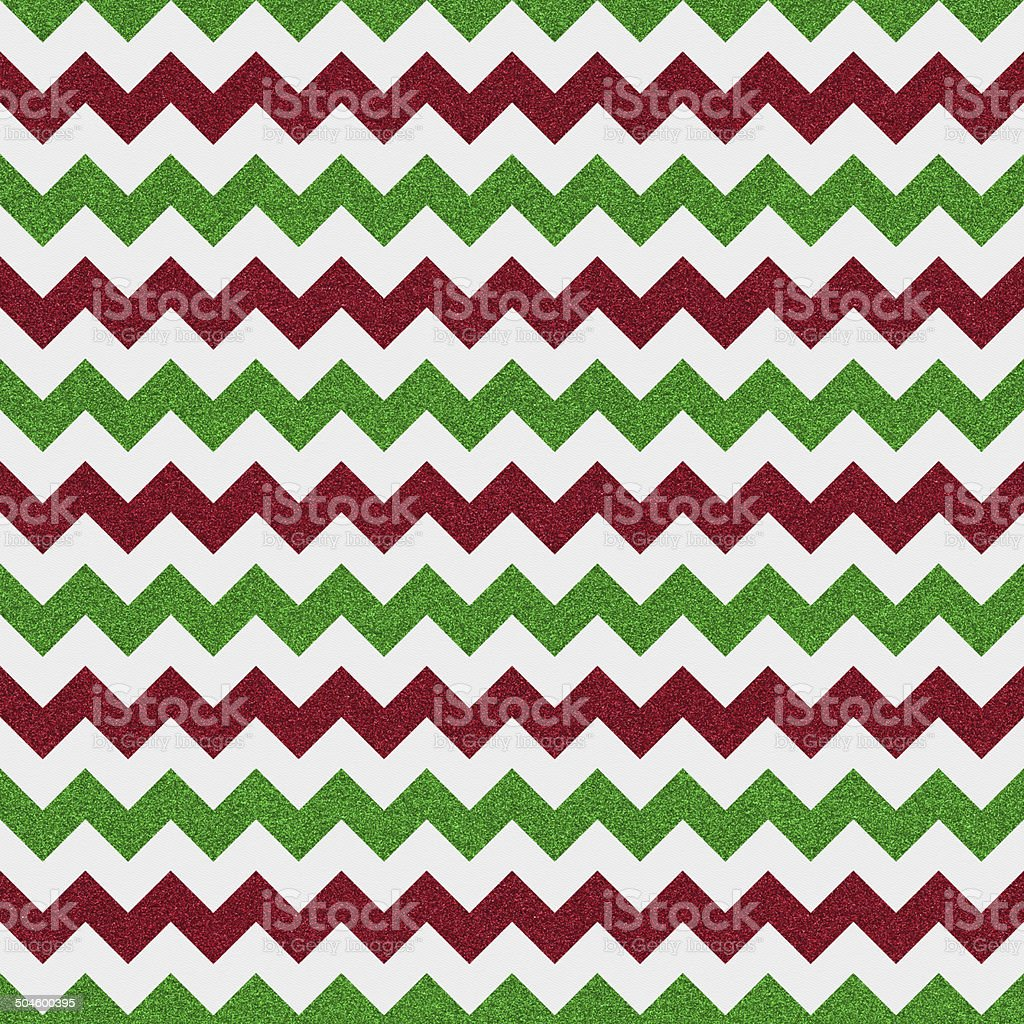 Seamless red and green chevron glitter pattern on paper stock photo