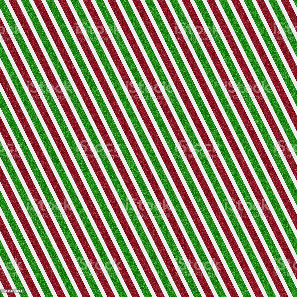 Seamless red and green glitter stripe pattern on white paper stock photo