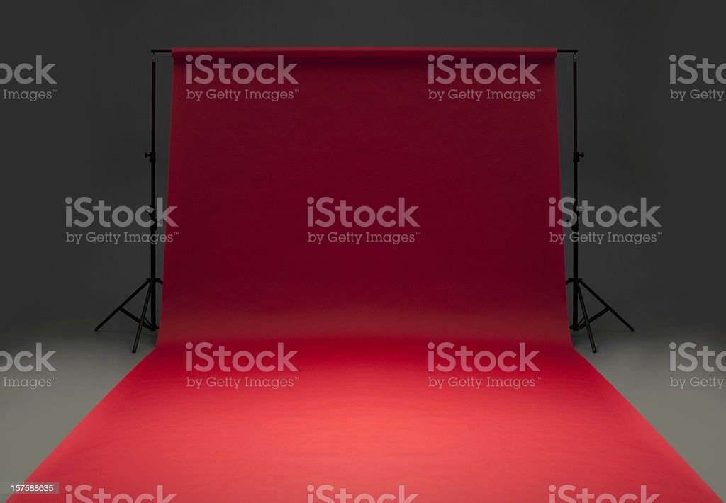 Seamless red background paper hanging on stands-isolated on grey royalty-free stock photo