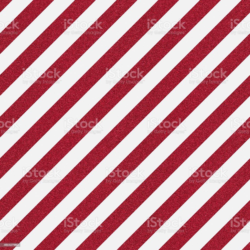 Seamless red glitter stripe on white textured paper stock photo
