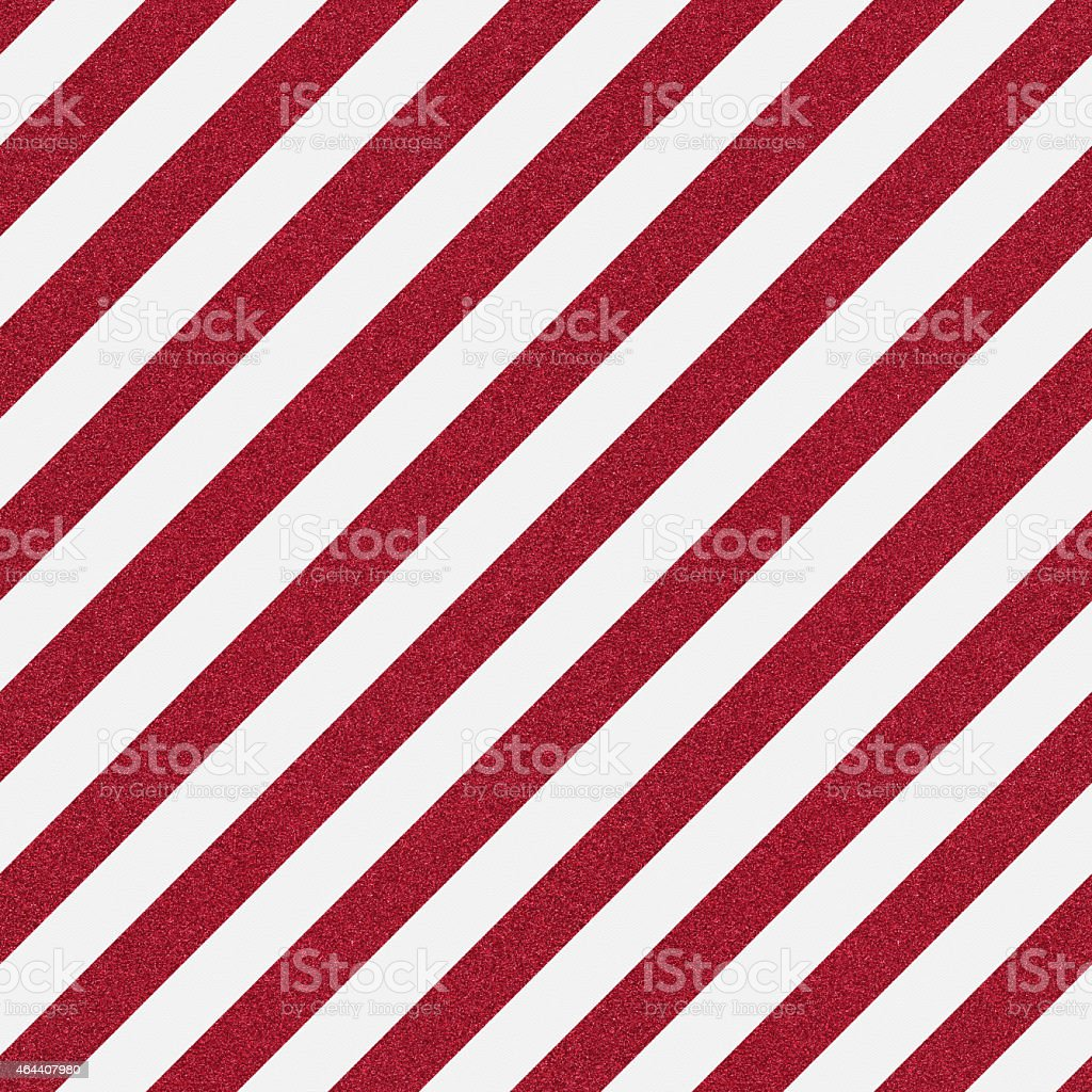 Seamless red glitter stripe on white textured paper stock photo