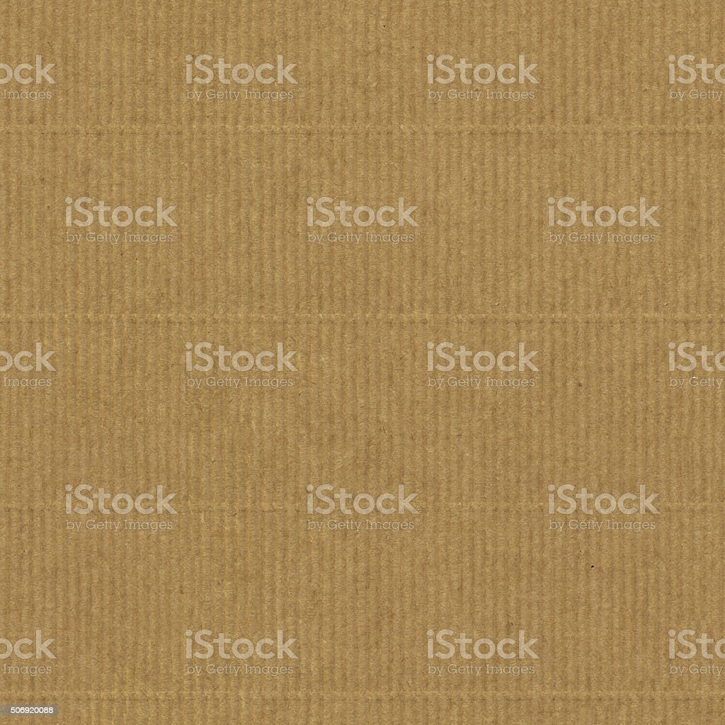 Seamless warm brown corrugated eco paper texture in vertical lines stock photo