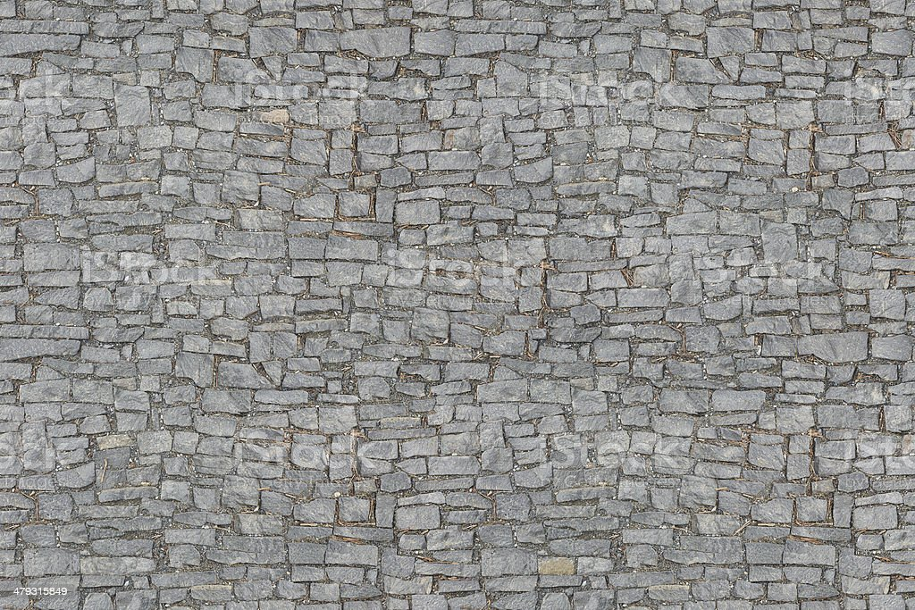 Seamlessly tiling cobbled road texture stock photo