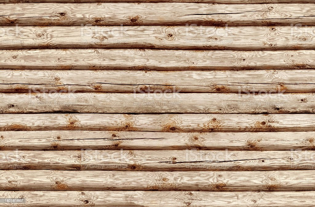 Seamlessly tiling wooden log wall. stock photo