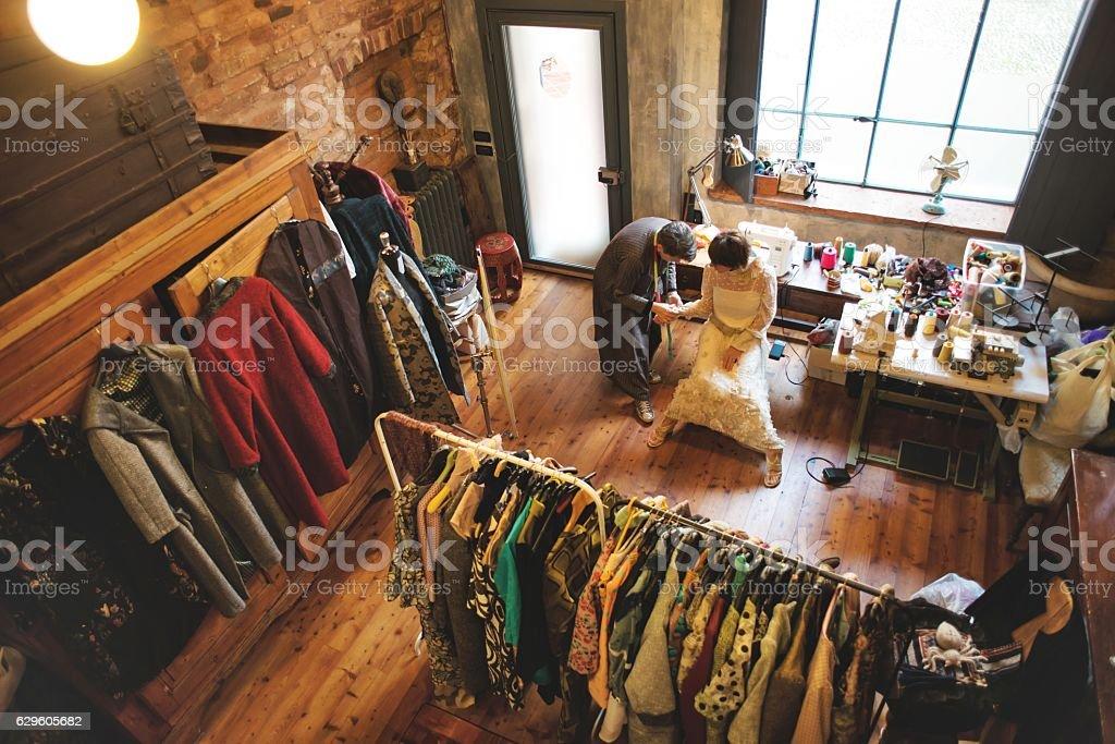 Seamstress and Customer stock photo
