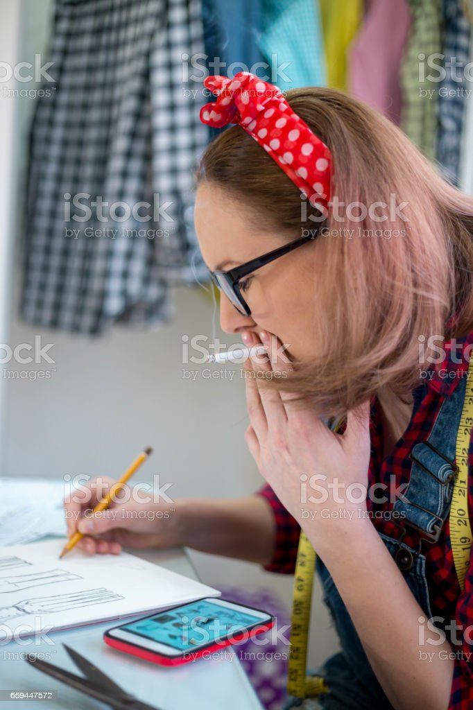 seamstress drawing templates in tracing paper stock photo