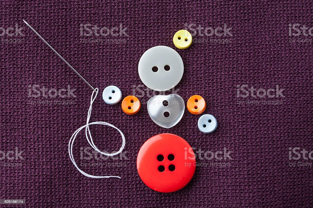 Seamstress girl conceptual design. Funny needlewoman character made of colorful stock photo
