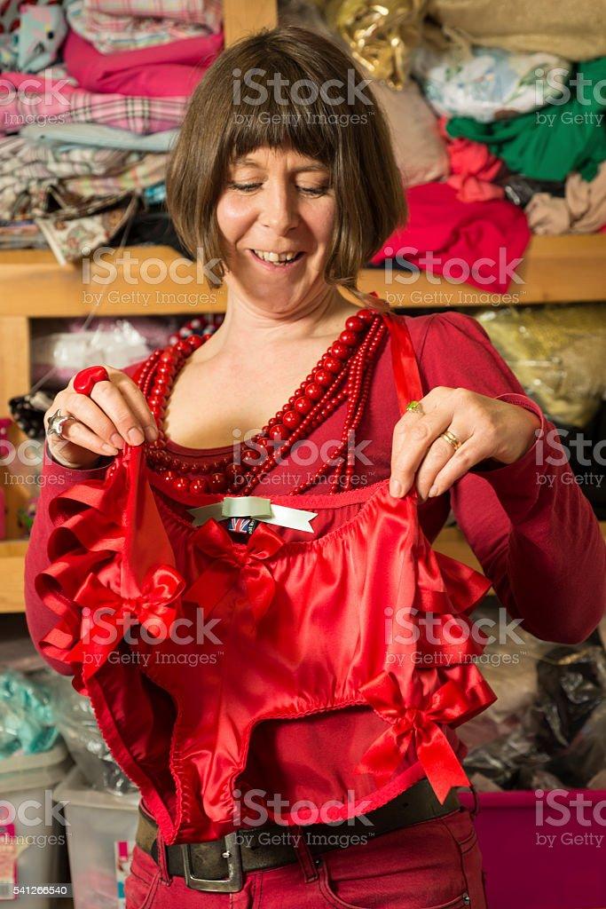 Seamstress Holding Newly-Sewn Red Fashion Knickers stock photo