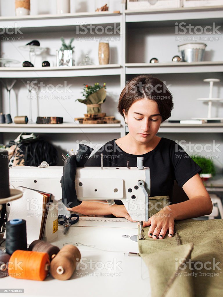seamstress making clothes. Workplace of  tailor stock photo