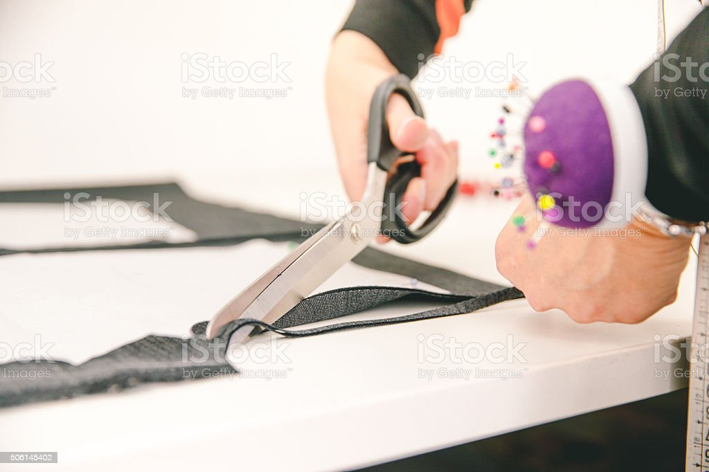 Seamstress or Tailor Cutting Fabric, Close-up stock photo