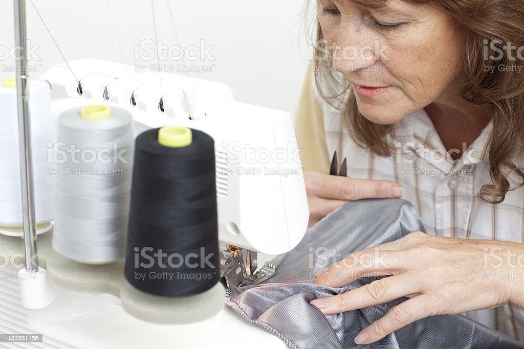 Seamstress sewing. royalty-free stock photo
