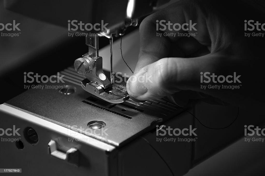 Seamstress Threading a Sewing Machine stock photo