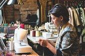 Seamstress Using the Sewing Machine