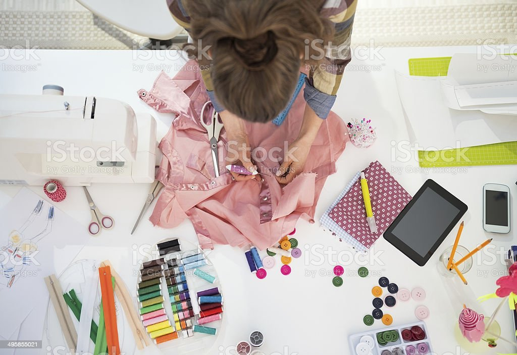 seamstress working in studio stock photo
