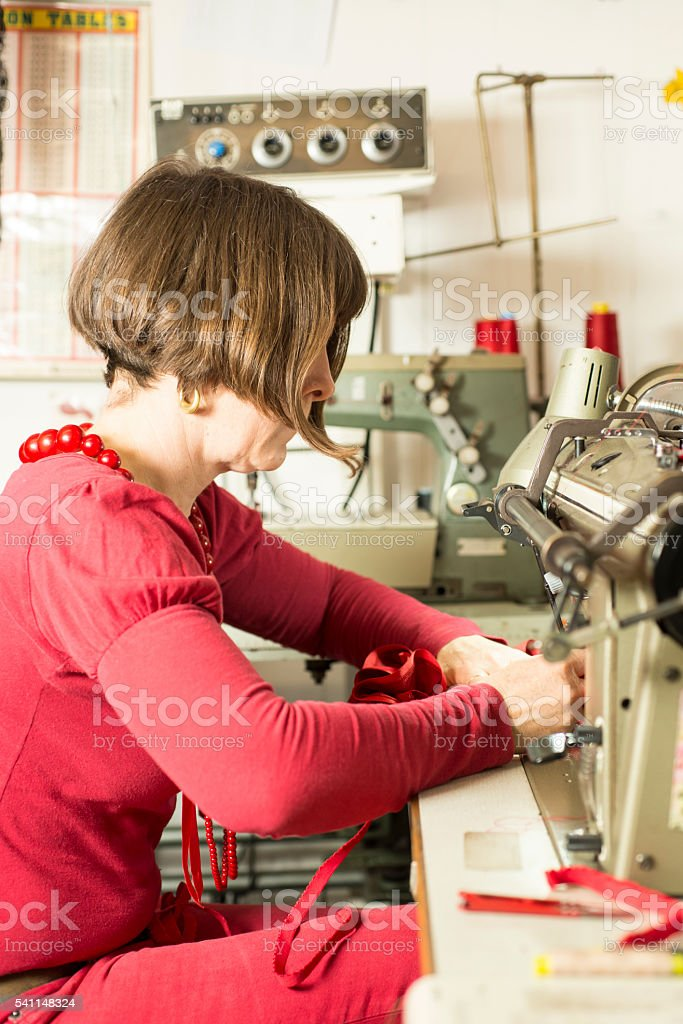 Seamstress Working on an Industrial Sewing Machine stock photo
