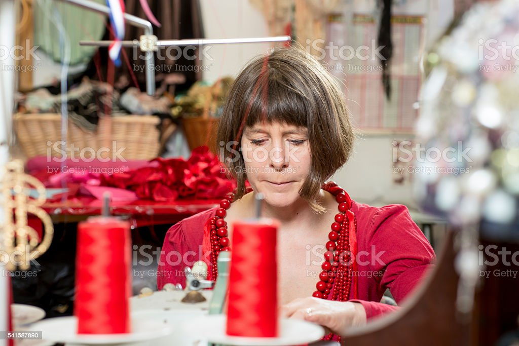 Seamstress Working with a Sewing Machine stock photo