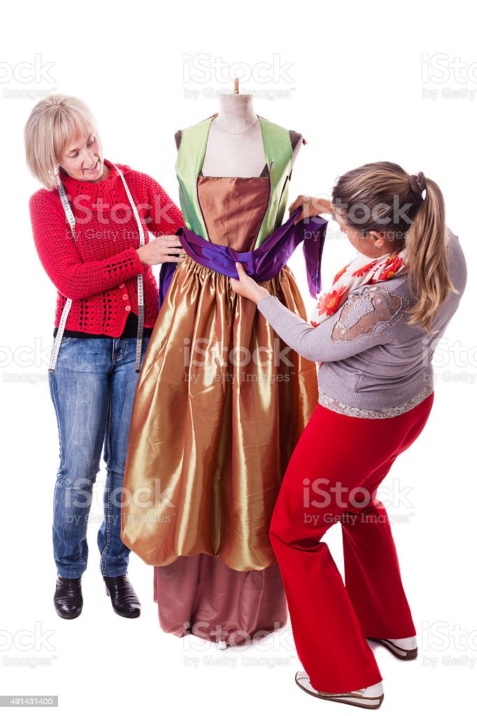 Seamstresses Working on a dress stock photo