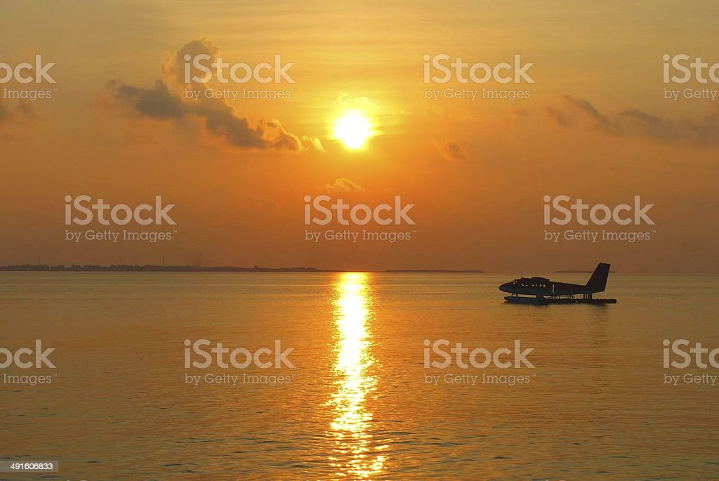 seaplane in the sunset stock photo