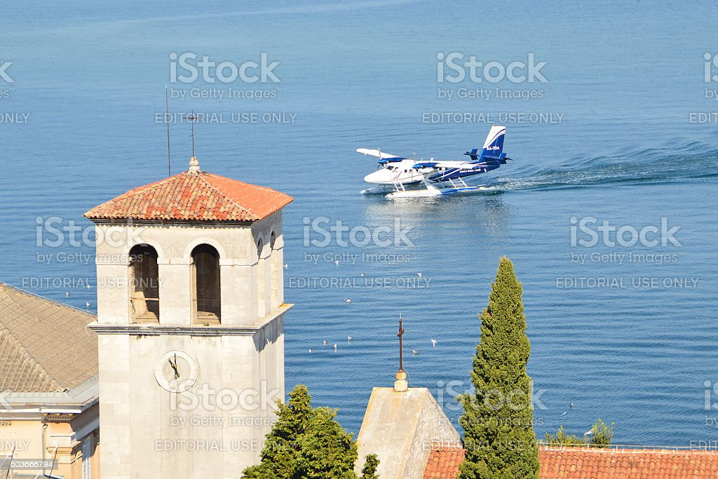 Seaplane landing on the water in the bay of Pula stock photo