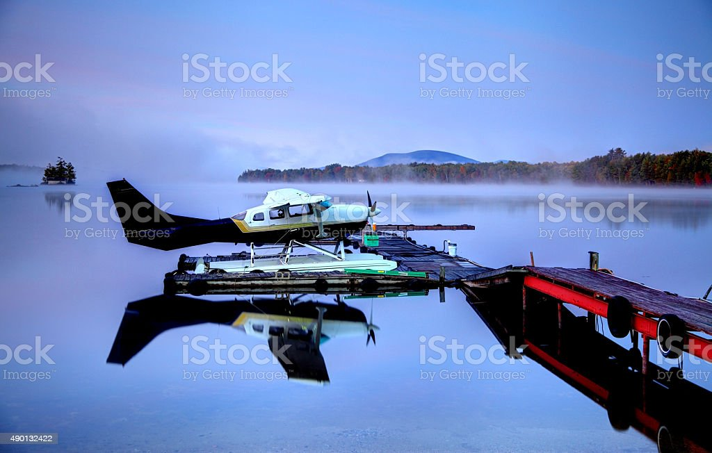 Seaplane on a calm lake in Maine stock photo