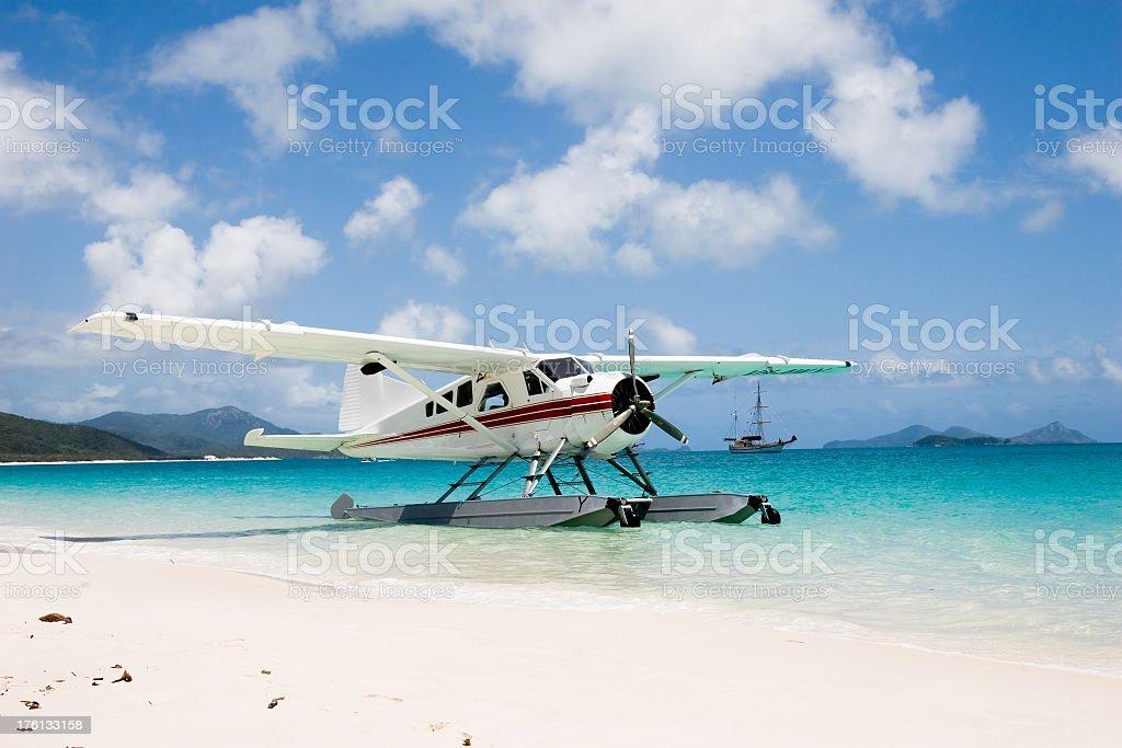 Seaplane on Whitehaven Beach stock photo