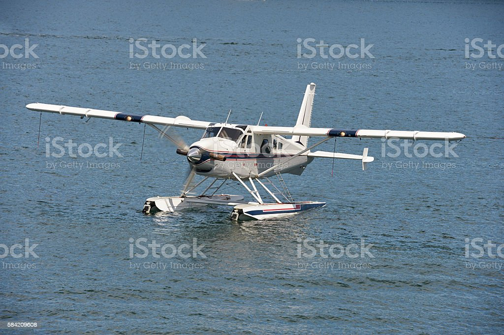 Seaplane taxiing on water stock photo