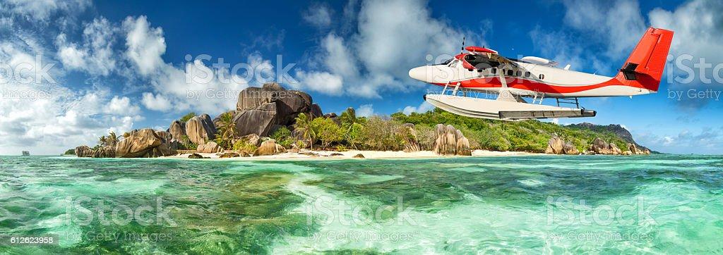 Seaplane with Seychelles island stock photo
