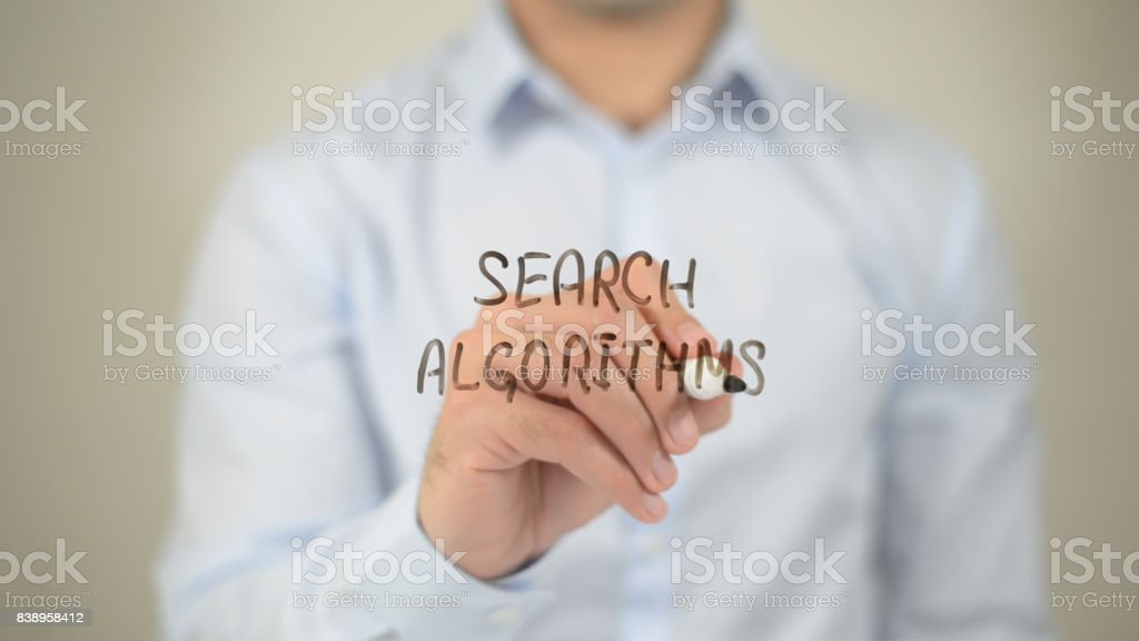 Search Algorithms , man writing on transparent screen stock photo