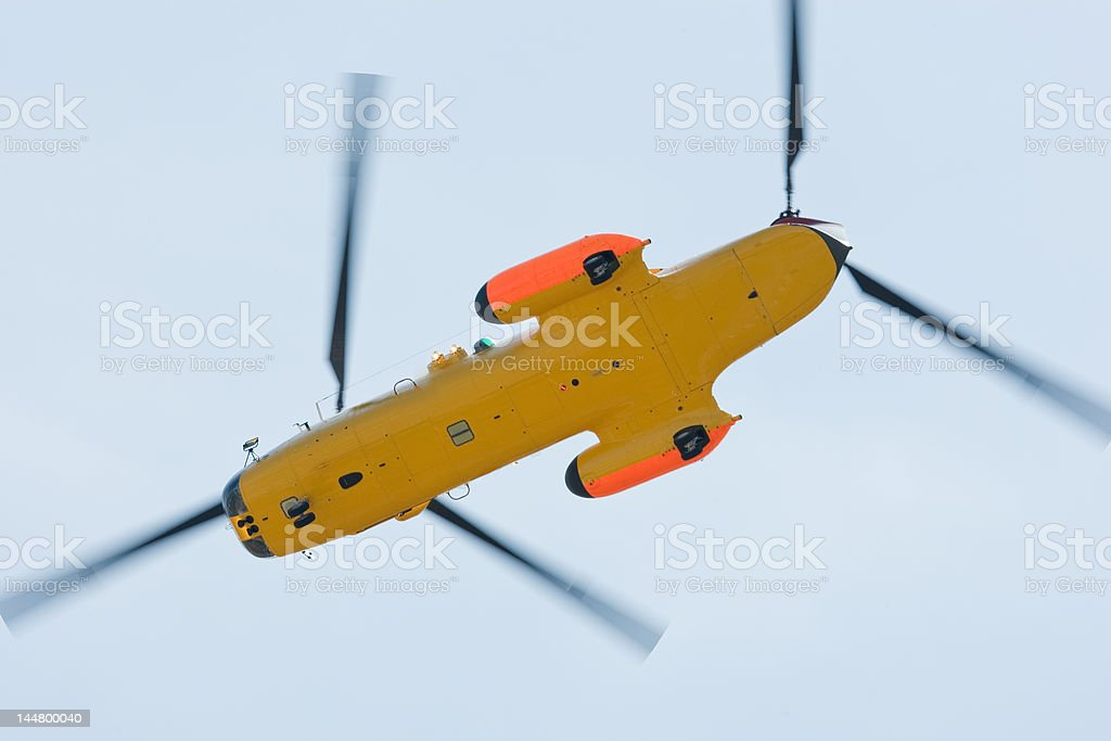 Search and rescue helicopter in flight stock photo