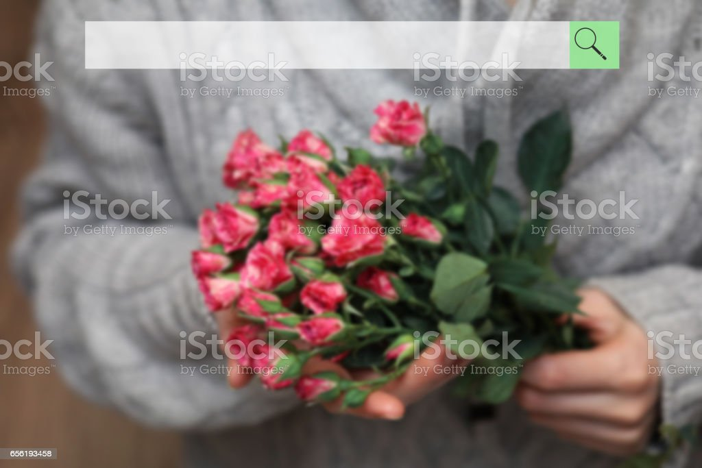 search bar on the background of blurred bouquet of bush of roses stock photo