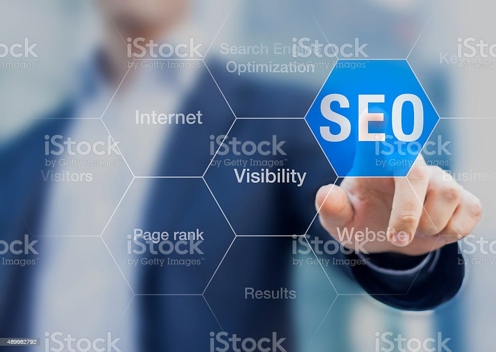 Search Engine Optimization consultant touching SEO button stock photo