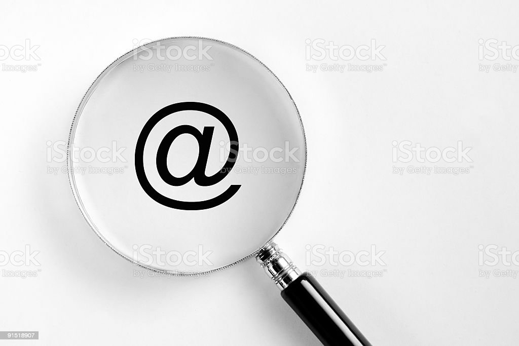 Search for Spam - @ at symbol in the microscope royalty-free stock photo