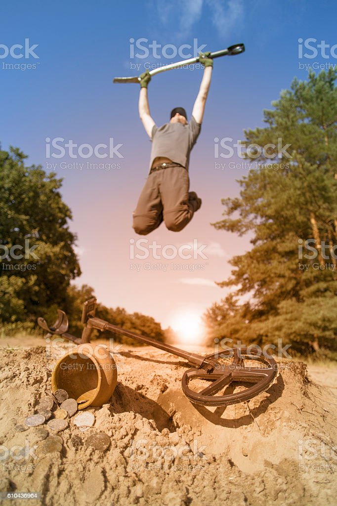 Search for treasure using a metal detector and shovel. stock photo