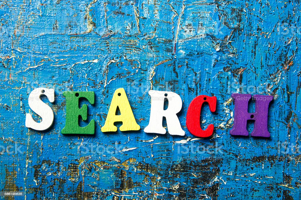 search word on wooden colorful abc letter at blue abstract stock photo