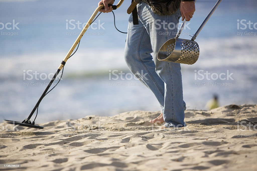Searches a beach royalty-free stock photo