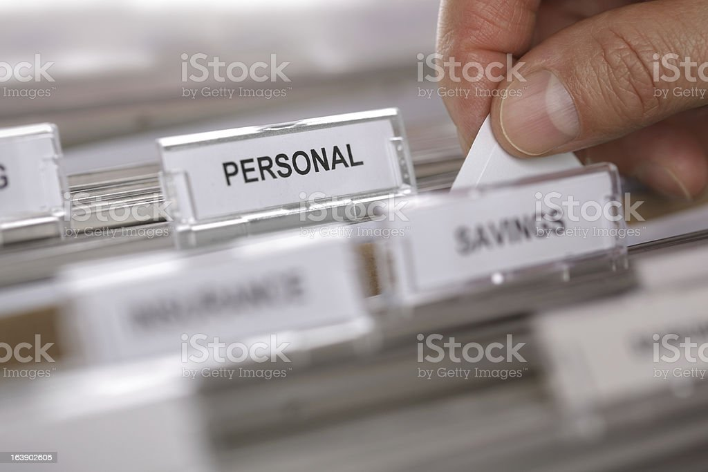 Searching a filing cabinet stock photo