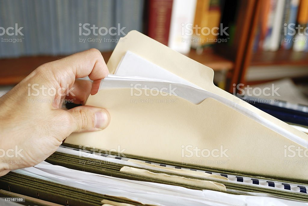 Searching a folder royalty-free stock photo