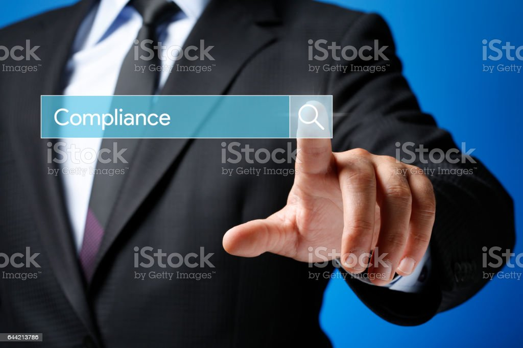 Searching Compliance Concept on Futuristic Touchscreen stock photo